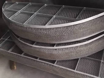 A monel round demister pad is divided into 3 sections and the 3 sections are placed together.