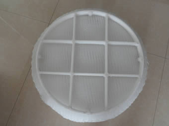 A round polypropylene demister pad with PP grid is and the grid is divided into 9 sections.