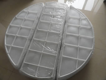 A round polypropylene demister pad is cut into 3 parts and the PP grid is divided into 40 sections.