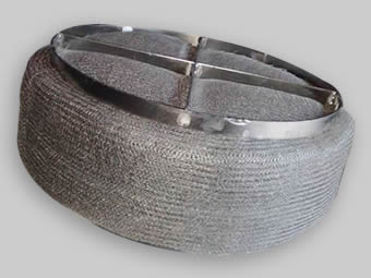 A round stainless steel demister pad with stainless steel grid and the grid is divided into 4 sections.