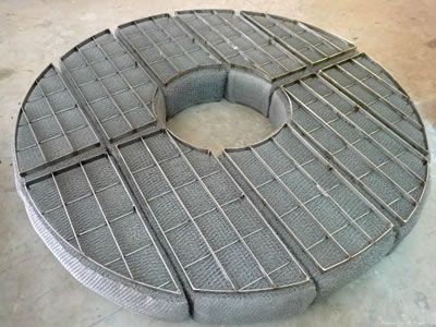 A round mist eliminator with 5 sections and grids.